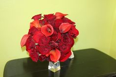 Bridal bouquet of red roses, dark red roses, red spray roses and red miniature calla lilies by Beautiful Blooms by Jen.
