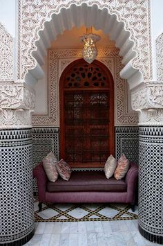 Decorated arch. Graphic patterns and almost lace-like detail.