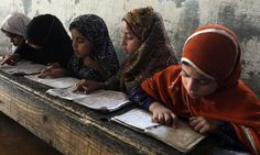 Pakistani Muslim girls attend a religious madrassa, or school, to learn the…