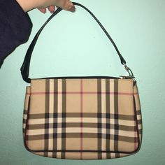 burberry mini bag good condition, purchased on posh and poshmark also authenticated if for me. i can post a screenshot of the email stating it is authentic upon request. no trades willing to negotiate make me offers! Burberry Bags Mini Bags