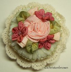 A Pincushion for Constance is included in the gallery section of my book Ribbonwork Flowers.