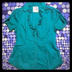 """ANTHROPOLOGIE teal blouse Edmé & Esyllte for Anthropologie. Collared short sleeve button down w deep vee. Ruffled bust, elasticized rouched back & sleeves. Stunning embroidery detail on shoulders& sleeves. 100% cotton. Teal color. Barely ever worn. Excellent condition. Labeled as a size 10. When laid flat, measures about 19.5"""" from armpit to armpit and about 26"""" from top of shoulder to hem.ABSOLUTELY NO TRADES. All offers must be made using the """"offer"""" option to be considered. No LOWBALLING…"""