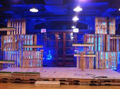 pallet stage design which if we used the totems as individual lightboxes could be very strong. So totem each with own lighting showing it's frame to look like window or mirror. Use fabric like a curtain to frame itself. (Karen)