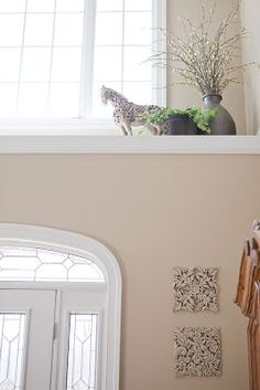 ~ delicious decor ~: How to decorate a high ledge in a front foyer