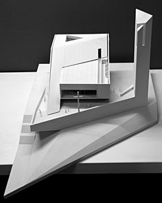 composed of a series of intersecting masses, the design of the church shifts to ideally link the interior to the surrounding landscape.