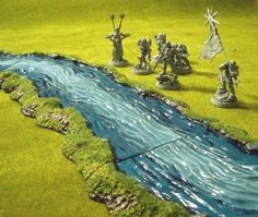 pre-painted river set from Pegasus.  Also, painted the river with Vallejo Still Water and flocked the banks