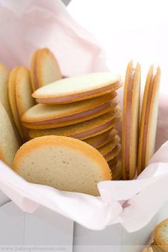 Milan Cookies - crisp, lemon-flavored cookies filled with white chocolate and raspberry ganache