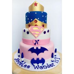 A 3-tiered superhero themed cake for a 1st birthday party today.  I was so excited when my old friend, @sorellet, asked me to do this cake for her daughter's special day. It turned out better than I envisioned.. It's perfect! Happy 1st birthday, Novalee Wonder. You are just so precious! #cakemeaway #cakemeawayfresno #1stbirthday #superherocake #girlsuperherocake #wonderwomancake #wonderwoman #batman #superman #1stbirthdaycake #superheroparty #customcakes #fondant #cakesofinstagram