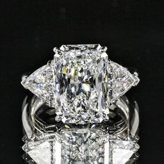 7.78ctw Three Stone Radiant and Trillion Diamond Ring set in White Gold