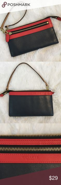 🆕Coach Navy & Red Wristlet Like New! Coach navy and red wristlet in like new condition. No known flaws. Logo embossed on front. Leather zipper pull. No tags. ❌NO TRADES ❌NO LOWBALLING ❌NO MODELING ❌ Coach Bags Clutches & Wristlets