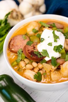 White Chicken Chili gets some cajun flair with andouille sausage, shrimp, and cajun spices for a hearty white chili that will knock your socks off! Cajun Recipes, Chili Recipes, Soup Recipes, Chicken Recipes, Cooking Recipes, Healthy Recipes, Cajun Chili Recipe, Savoury Recipes, Healthy Foods