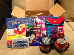 Christmas Eve box!! Christmas Book, Christmas Movie, Popcorn, New Christmas Pj's, Hot Chocolate and Christmas Mugs