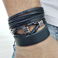 Kit 3 pulseiras masculinas sendo: -1 pulseira de couro trançado na cor preto com detalhes de metal em banho níquel fechamento magnético em banho níquel. -1 p...