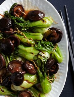 Bok choy is usually stir-fried, but Bryant Ng char-grills it until it's smoky, tops it with deeply savory braised shiitake, then drizzles the dish with a ginger-scented oyster sauce. Vegetable Dishes, Vegetable Recipes, Vegetarian Recipes, Healthy Recipes, Wine Recipes, Asian Recipes, Cooking Recipes, Grilled Bok Choy, Bok Choy Recipes
