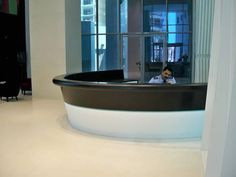 Solid Surface thermoformed reception desk. AE Hadley.