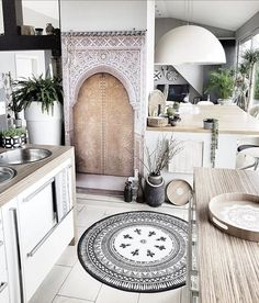 This monochrome Scandi boho kitchen belongs to Claudia from @belliwood _boholiving. She creates her own DIY cushions and other boho home accessories paired with vintage wood and white throughout along with this gorgeous monochrome rug creating an inspiring and beautifully individual home. Take a look...