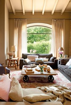 Love how the curtains add height to the room. + the coffee table!