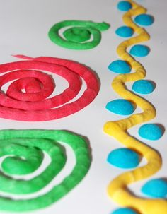 Paint that grows. Mix 1 cup flour, 3 tsp baking powder, 1 tsp salt, and enough water to make consistency of pancake batter. Divide into 4 parts and put in snack size Ziploc baggies along with food coloring. Squish it around to mix up the colors. Rubber band like icing bag and snip tiny hole. Squeeze to paint and then  pop paper in microwave for 30-45 seconds and watch the paint puff up and grow.