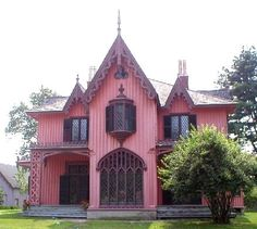 Craig  Yvonne's Victorian Home ~ Gothic Revival Peaked~1840-1880  The earliest traces of Gothic revival architecture are seen in churches and monasteries in England dating back to the mid-18th century. Exteriors had Lancet windows, pointed arches, windows in the form of trefoils and quatrefoils (representing the Holy Trinity  cross),battlement keep  a cone-topped tower.  The walls were castellated, chimneys are grouped in Tudor fashion.Popular in England around 1810 for cottages.