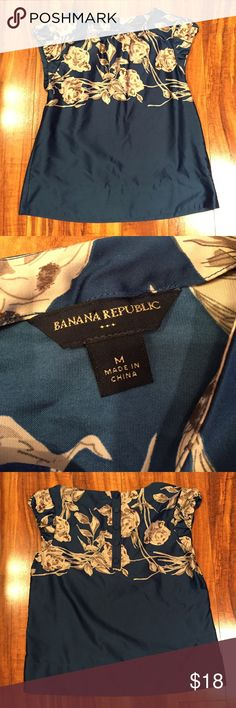 Banana Republic Top Banana Republic top. Blue with tan/cream flowers. Silky texture, but made of 100% polyester. Adorable buttons down the back. Make an offer or bundle to save 15%! Banana Republic Tops Blouses
