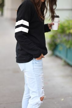Sweatshirt  ripped jeans.  -I need a light blue pair of jeans to go with this sweatshirt too