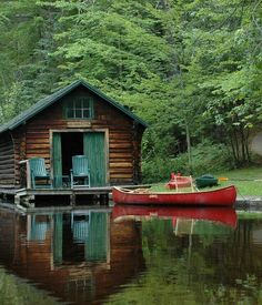 cabin by the water. boat. chairs. love.