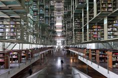 Mexico City The library's interior has a futuristic appeal, featuring a soaring grand central hall inhabited by a matrix of glass-and-steel boxes. Appearing to hover in midair, the elevated bookshelves provide plenty of room for future growth—only one-third full at present, they offer space for 1.5 million books.