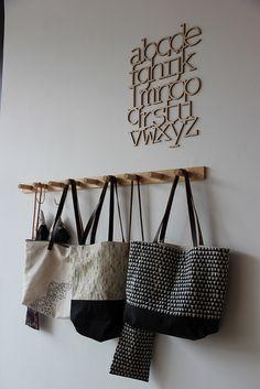 Timber peg coat rack and wood alphabet decor