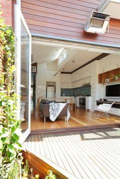 open plan living extending onto a deck area