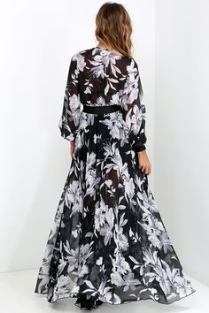 As Seen On Elizabeth of A Keene Sense of Style blog! With the ocean on all sides and a cocktail in your hand, the Buzios Beauty Black and Ivory Floral Print Maxi Dress will feel right at home! Get glamorous in the sheer bodice with plunging V neckline and long billowy sleeves that end in shiny elastic cuffs. The lightweight woven fabric (with a gorgeous ivory floral print) continues from the banded elastic waist, into a full and elegant maxi skirt. Bralette not included.
