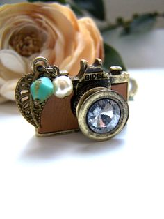 How cute! Tan leather camera necklace by barberryandlace on Etsy, $23.00