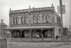 """""""Elson chemist and Dutton bookshop on Courtenay Place, Wellington, between 1896 and 1897."""""""