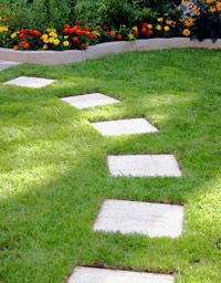 Find tips on how to design and layout a stepping stone path in your yard. Find tips on how to design and layout a stepping stone path in your yard.