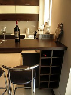 Jednym z najgorszych miejsc do przechowywania wina są domowe kuchnie - jest tam. Home cooking is one of the worst places to store wine - it's usually too hot there! Learn how to store wine corre Wine Storage Cabinets, Storage Design, Office Desk, Corner Desk, Minimalist, Homemade, Store, Places, Table