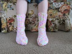 """Here is a wonderful pair of hand knit adult size socks. Heel to toe is approx. 10 in. and the ribbing on the top (top to ankle) is approx. 5 1/2 in. The yarn color is called """"Tiny Tulips."""" These socks are made of 100% acrylic yarn and can be machine washed and dried."""