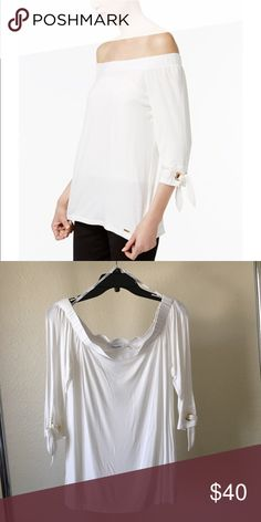c9164a357df7b CK off shoulder Top Tie cuffs add endless charm to this 3 4 sleeve top