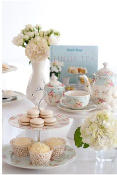 Macarons, cupcakes, flowers, ... all setting the scene for a lovely high tea ceremony