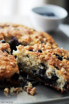Lightened-Up Blueberry Coffee Cake - Soft, light and airy, this coffee cake is loaded with fresh blueberries and topped with sweet, crunchy walnuts.