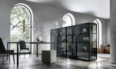 black aluminum frame, doors and glass shelves in transparent gray. Sides and back in gray reflective glass. Base and top in black oak.