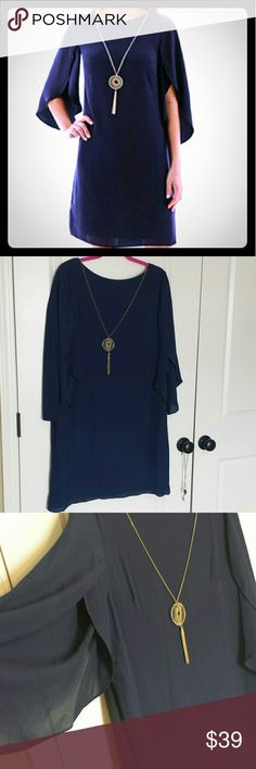 """Dark Blue Dres Dress with fly away arms, straight cut, very flattering. Gold chain in the front is removable. Lined.   Size 14.  37"""" long and  20' wide armpit to armpit measured flat.  Zipper and hook.closuere in the back. Dresses"""