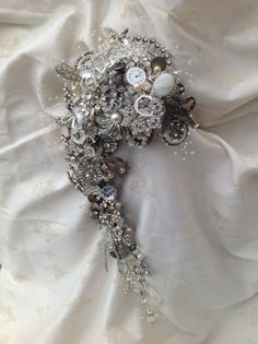 Stunning semi crescent 2ft long vintage brooch, embellishment bridal bouquet, created by Michele knibbs of Muscari whites florist. @Muscari Whites Florist #muscariwhitesflorist www.muscariwhites.co.uk