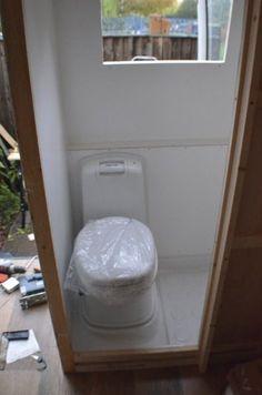 Building shower/toilet in van conversion.
