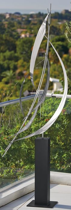 Let simple arcs of stainless steel inspire open-air tales of wind-filled sails and crescent moons.  | Frontgate: Live Beautifully Outdoors