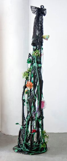 This is fine art and abstract art in the form of contemporary sculpture. All Dressed Up. Made with flowers, PVC vinyl tubing, steel plate, steel rods, steel leaves, fabrics, electrical wire, paint. www.nikiketchman.com #NikiKetchmanFineArt