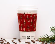 New to Chockrosa on Etsy: Fabric Coffee Cozy | Red Candy Cane | Cozies | Stocking stuffer | Drink Sleeve | Black lining | Reversible | Womens Mens gift | Koozie