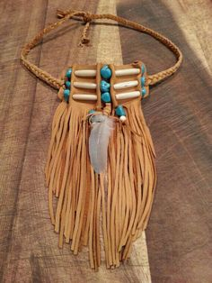"""Native American bone beaded fringed choker by TribalTerri on Etsy.Note the folded leather around the nested beads, and the fringe gives such a nice sense of """"flow""""."""