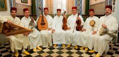 Arts:This is a picture of an Andalusian band in Morocco. Some traditional music forms are Berber, Gnaouan, Chebbi,  and Arab-Andalusian. Gnaouan is from the Sahara area in Africa. Moroccan folk music has influences of  Andalusian music. Andalusian and Griha are very popular types of music in Morocco.