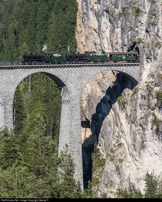 """For the celebration of 125 years Railway in Graubünden, the RhB organized a double traction steam train with her two """"Consolidations"""" G 4/5 # 107 """"Albula"""" and # 108 """"Engadina"""" from Landquart via Chur-Thusis-Tiefencastel and through the numerous spiral tunnels of the Albula line to Samedan in the Engadin and all the way back, without any electric or diesel backup. The train is on the return journey and just crossing the 65 meter high Landwasser viaduct."""