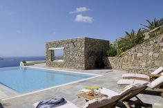 Infinity pool and pergola next to it. Music is played with waterproof speakers.
