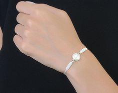 Toda mi joyería es mano hecha a mano con pura y 925 de plata. El color oro se hace por la plata de recubrimiento con oro de 18. Esta pulsera está diseñada